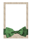Old paper frame with beautiful bow. Old paper frame with beautiful green bow Royalty Free Stock Images