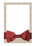 Old paper frame with beautiful bow. Old paper frame with beautiful red bow Stock Photography
