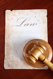 Old paper with gavel. Old paper with word law and judges wooden gavel Royalty Free Stock Photo