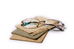 Old paper and glasses. Aged brown old paper, isolated Royalty Free Stock Photography