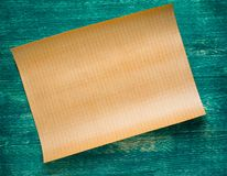 Old paper on green wooden background Royalty Free Stock Photos