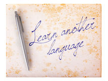 Old paper grunge background - Learn another language Stock Images