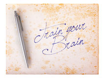 Old paper grunge background - Train your brain Stock Image