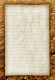 Old paper on brown ground texture. Royalty Free Stock Images