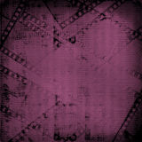 Old paper and grunge filmstrip. On the abstract background Stock Image