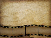 Old paper in grunge style with  filmstrip. Abstract background Stock Photos