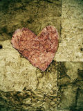 Old paper heart. In a background of textured old paper Royalty Free Stock Photography