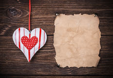 Old paper with heart Royalty Free Stock Images