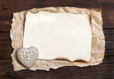 Old paper and  heart on the wood background Royalty Free Stock Images