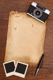 Old paper, ink pen and vintage photo frame with camera Royalty Free Stock Images