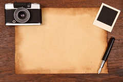 Old paper, ink pen and vintage photo frame with camera Royalty Free Stock Photos