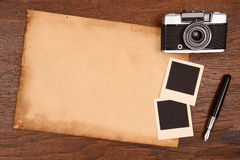 Old paper, ink pen and vintage photo frame with camera Royalty Free Stock Photography