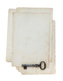 Old paper and key. Stock Images