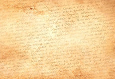 Old paper with latin text. Old brown paper with hand written text in latin stock photography