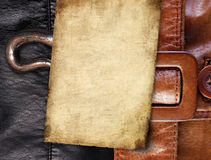 Old paper on leather background Royalty Free Stock Photography