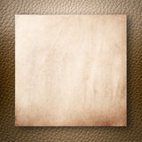 Old Paper On Light Brown Leatherette Royalty Free Stock Photography