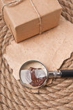 Old paper and magnifier Royalty Free Stock Image