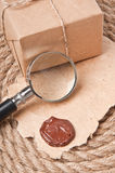 Old paper and magnifier Stock Photo
