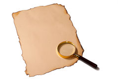 Old paper and magnifier Stock Image