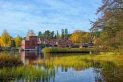 Old paper mill buildings. Of red brick at sunny autumn day. Verla Groundwood and Board Mill - Museum. Finland royalty free stock photography