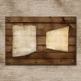 Old paper nailed to a wooden board Royalty Free Stock Images