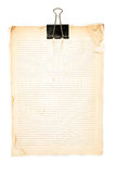 Old paper note and Black clip. On white background Stock Photography