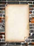 Old Paper on Old Brick Wall. Background Stock Photography