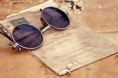 Old paper and old glasses Royalty Free Stock Image
