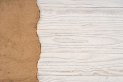Old paper on an old white wooden table. Royalty Free Stock Images