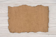 Old paper on an old white wooden table. Royalty Free Stock Photo