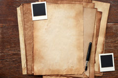 Old paper and pen with photo frame. For background Stock Photos