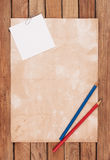 Old paper with pencils background Stock Photos