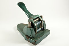 Old paper perforator. On white background Royalty Free Stock Image