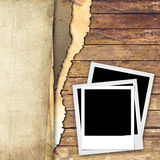 Old paper and photo frame on wood background. Ripped paper and photo frame on wood background royalty free stock image
