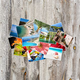 Old paper and photos on wooden background. Royalty Free Stock Photos