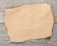 Old paper piece on wooden textured background Royalty Free Stock Image