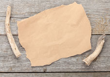 Old paper piece on wooden textured background Royalty Free Stock Images