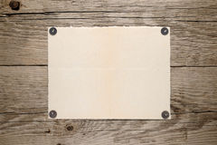 Old paper pinned to wall Stock Photo
