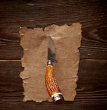 Old paper pinned to a wooden wall Royalty Free Stock Photo