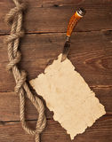 Old paper pinned to a wooden wall Stock Image