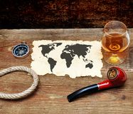 Old paper, pipe and glass of cognac Stock Photo