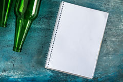 Old paper is placed on the table with a bottle of empty wine pla. Ced together stock images