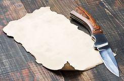 Old paper and pocket knife Stock Photos