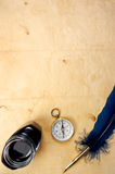 Old paper with quill and ink. Old paper background with retro quill pen and compass royalty free stock images