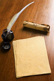 Old Paper, Quill Pen And Scroll On Wooden Table Royalty Free Stock Photos