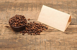 Old paper for recipes and coffee beans Royalty Free Stock Photo