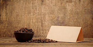 Old paper for recipes and coffee beans Stock Photography