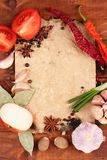Old paper for recipes and spices. On wooden table royalty free stock photography