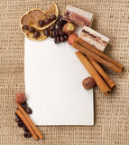 Old paper for recipes and spices on burlap. Closeup Stock Images