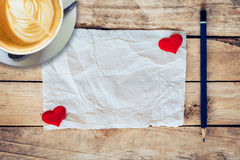 Old paper and red heart, coffee cup with pencil on wood backgrou Stock Image